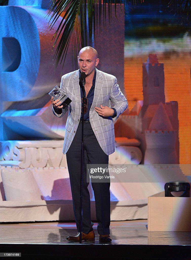 Pitbull accepts an award onstage during the Premios Juventud 2013 at Bank United Center on July 18, 2013 in Miami, Florida.