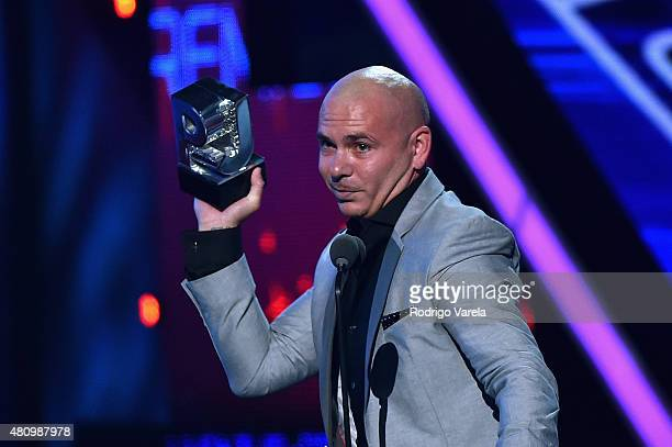 Pitbull accepts award onstage at Univision's Premios Juventud 2015 at Bank United Center on July 16 2015 in Miami Florida