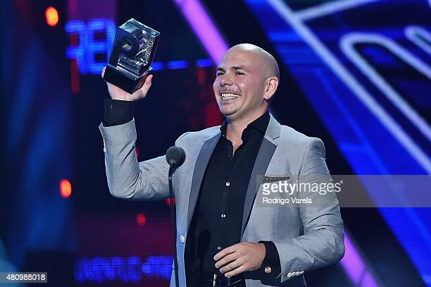 Pitbull accepts award onstage at Univision's Premios Juventud 2015 at Bank United Center on July 16 2015 in Miami Florida