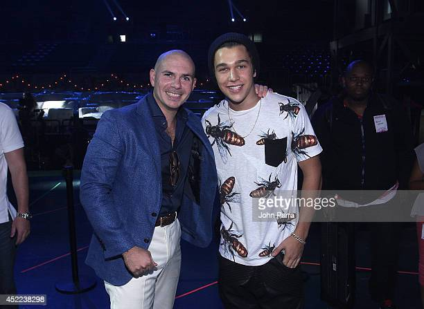Pitbull and Austin Mahone attend the Premios Juventud 2014 Rehearsal at the BankUnited Center on July 16 2014 in Miami Florida