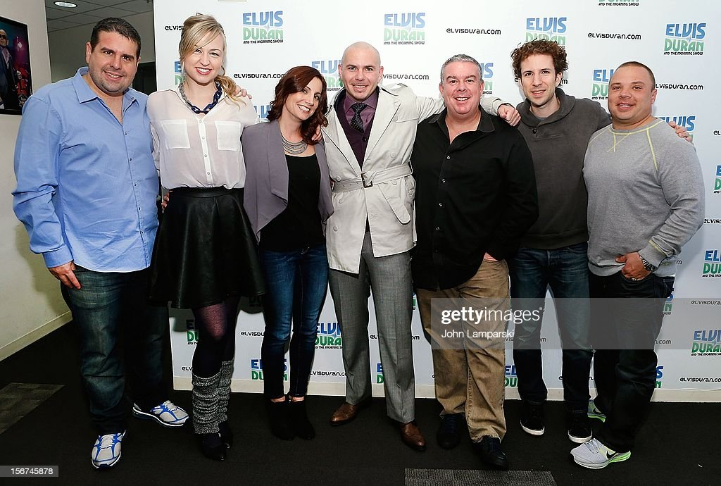 Pitbull (C) and <a gi-track='captionPersonalityLinkClicked' href=/galleries/search?phrase=Elvis+Duran&family=editorial&specificpeople=3048281 ng-click='$event.stopPropagation()'>Elvis Duran</a> (3rd R) and the Z100 morning crew visit at Z100 Studio on November 20, 2012 in New York City.