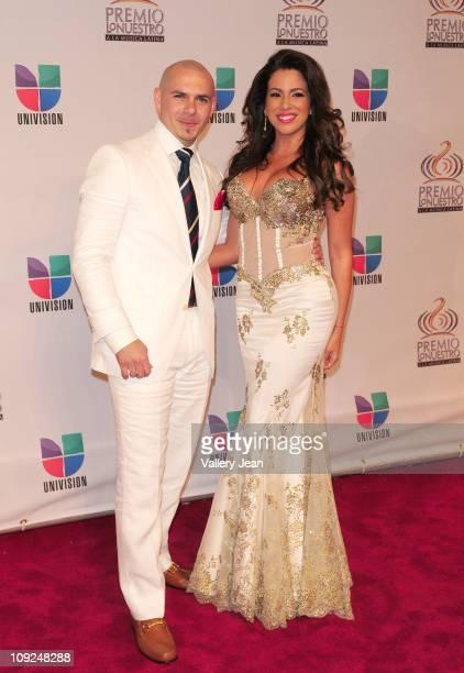 Pitbull and guest arrive at Univision's Premio Lo Nuestro a La Musica Latina Awards at AmericanAirlines Arena on February 17 2011 in Miami Florida
