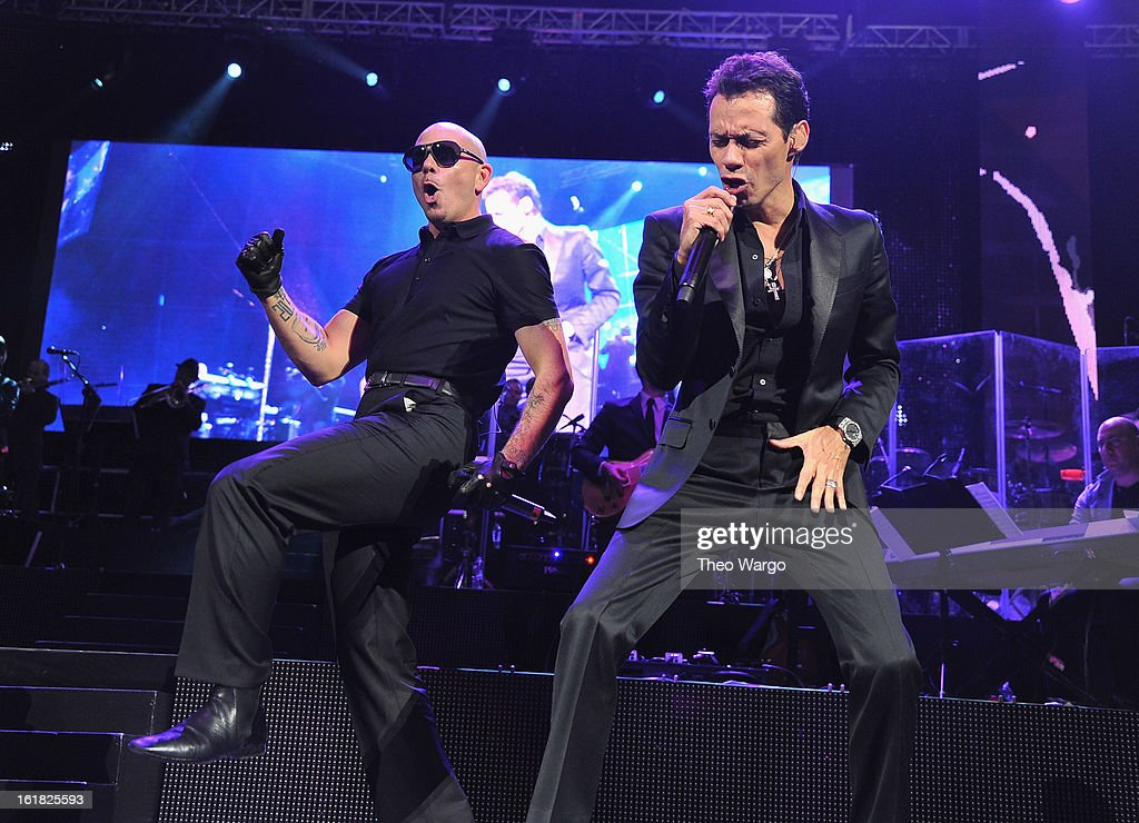 Pitbull and <a gi-track='captionPersonalityLinkClicked' href=/galleries/search?phrase=Marc+Anthony&family=editorial&specificpeople=202544 ng-click='$event.stopPropagation()'>Marc Anthony</a> perform at Barclays Center on February 16, 2013 in the Brooklyn borough of New York City.