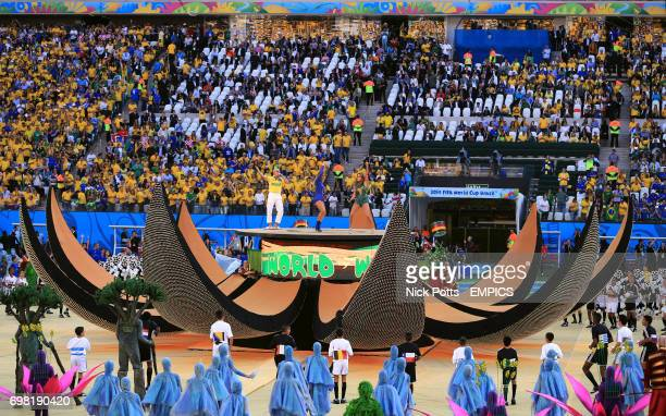 Pitbull Claudia Leitte and Jennifer Lopez perform during the opening ceremony at the Arena Corinthians in the build up for the opening match of the...