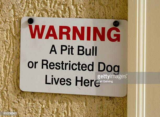 AURORA CO 12705 Pitbull owner Wayne Forst has complied with all the city ordinances to keep his dog Lazerus in his home including posting a sign next...