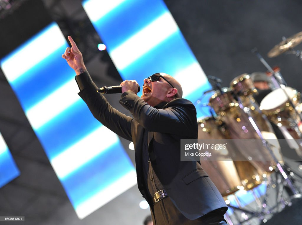 PitBull performs at DIRECTV'S Seventh Annual Celebrity Beach Bowl at DTV SuperFan Stadium at Mardi Gras World on February 2, 2013 in New Orleans, Louisiana.