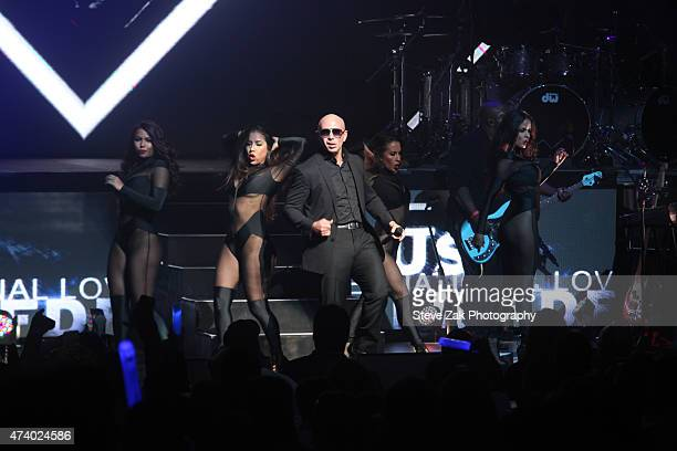 Pitbull performs at SiriusXM Pitbull's Globalization Channel Launch Concert at The Apollo Theater on May 19 2015 in New York City