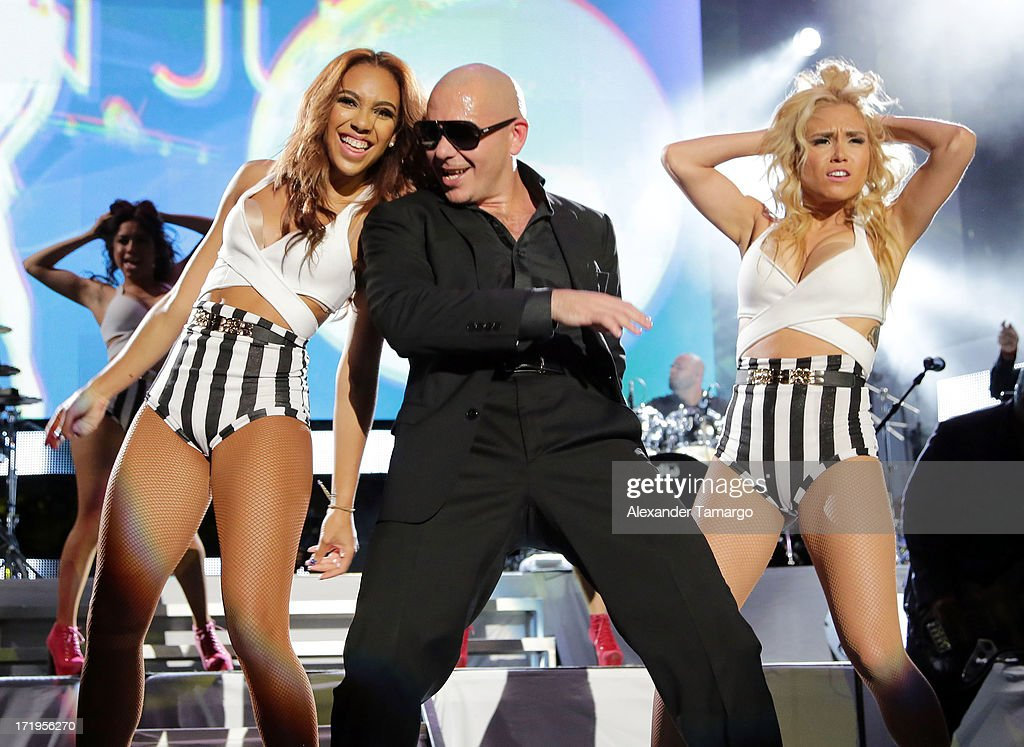 Pitbull performs at the iHeartRadio Ultimate Pool Party Presented By VISIT FLORIDA at Fontainebleau Miami Beach on June 29, 2013 in Miami Beach, Florida.