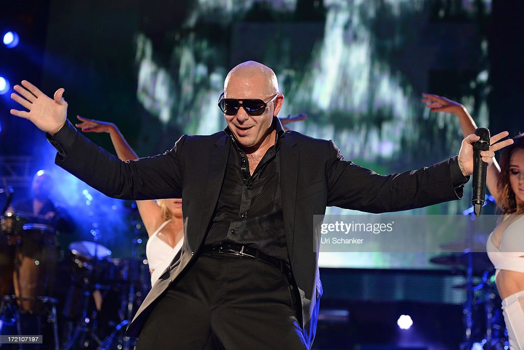 Pitbull performs at the iHeartRadio Ultimate Pool Party Presented By VISIT FLORIDA At Fontainebleau's BleauLive at Fontainebleau Miami Beach on June 29, 2013 in Miami Beach, Florida.