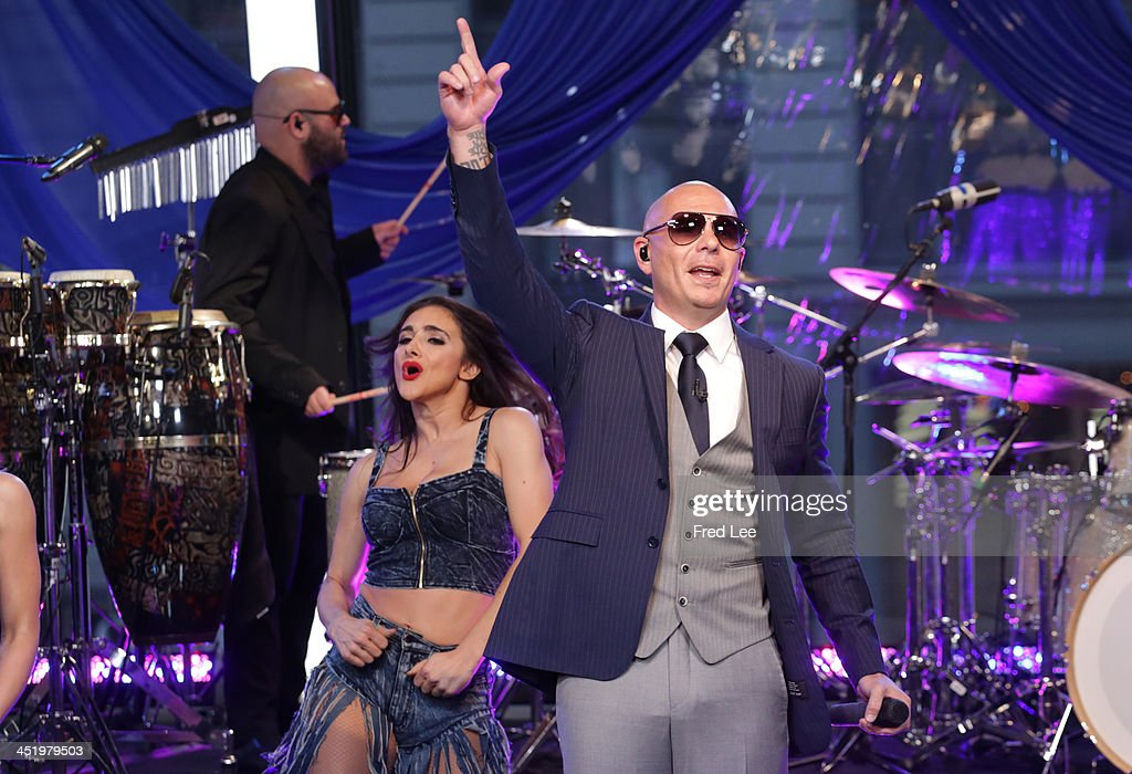 AMERICA - Pitbull performs live on 'Good Morning America,' 11/25/13, airing on the ABC Television Network PITBULL