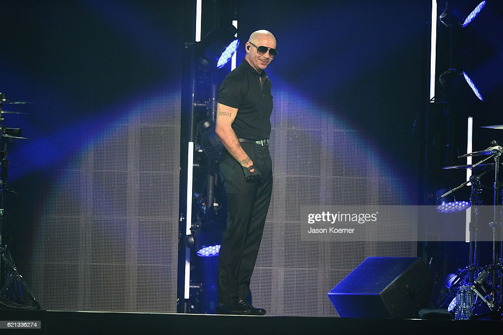 Pitbull performs on stage at iHeartRadio Fiesta Latina at American Airlines Arena on November 5, 2016 in Miami, Florida.