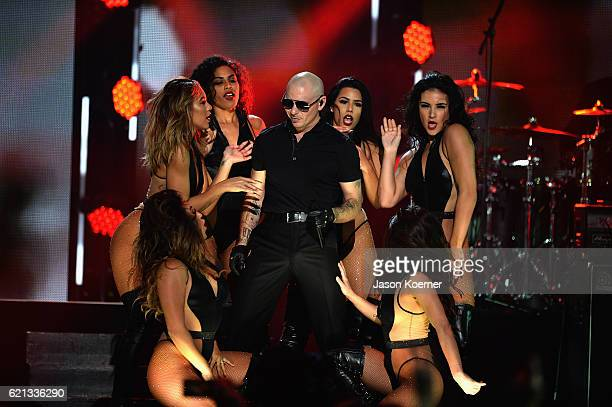 Pitbull performs on stage at iHeartRadio Fiesta Latina at American Airlines Arena on November 5 2016 in Miami Florida