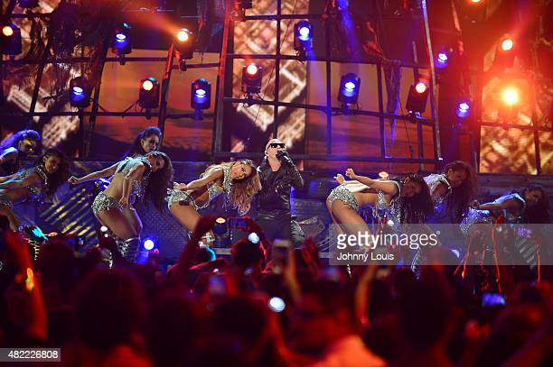 Pitbull performs onstage at the Univision's Premios Juventud 2015 at Bank United Center on July 16 2015 in Miami Florida