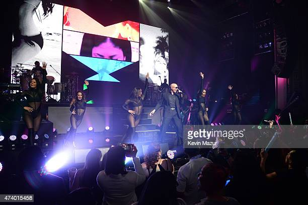Pitbull performs onstage in celebration of the launch of his SiriusXM channel at The Apollo Theater on May 19 2015 in New York City