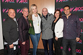 Pitbull poses with Greg T Elvis Duran Bethany Watson Danielle Monaro and Skeery Jones during his visit to 'The Elvis Duran Z100 Morning Show' at One...