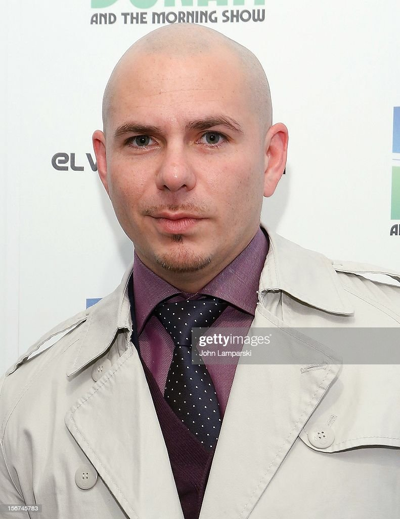 Pitbull visits the Elvis Duran Morning Show at Z100 Studio on November 20, 2012 in New York City.