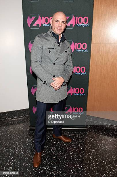 Pitbull visits 'The Elvis Duran Z100 Morning Show' at One World Observatory on December 1 2015 in New York City