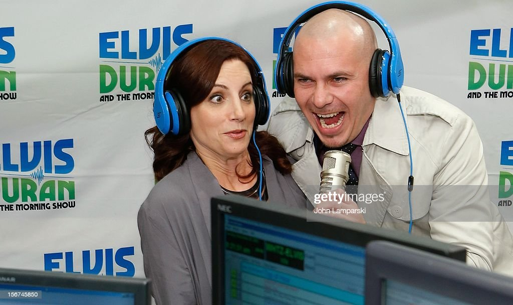 Pitbull (R) visits the Elvis Duran Z100 Morning Show at Z100 Studio on November 20, 2012 in New York City.