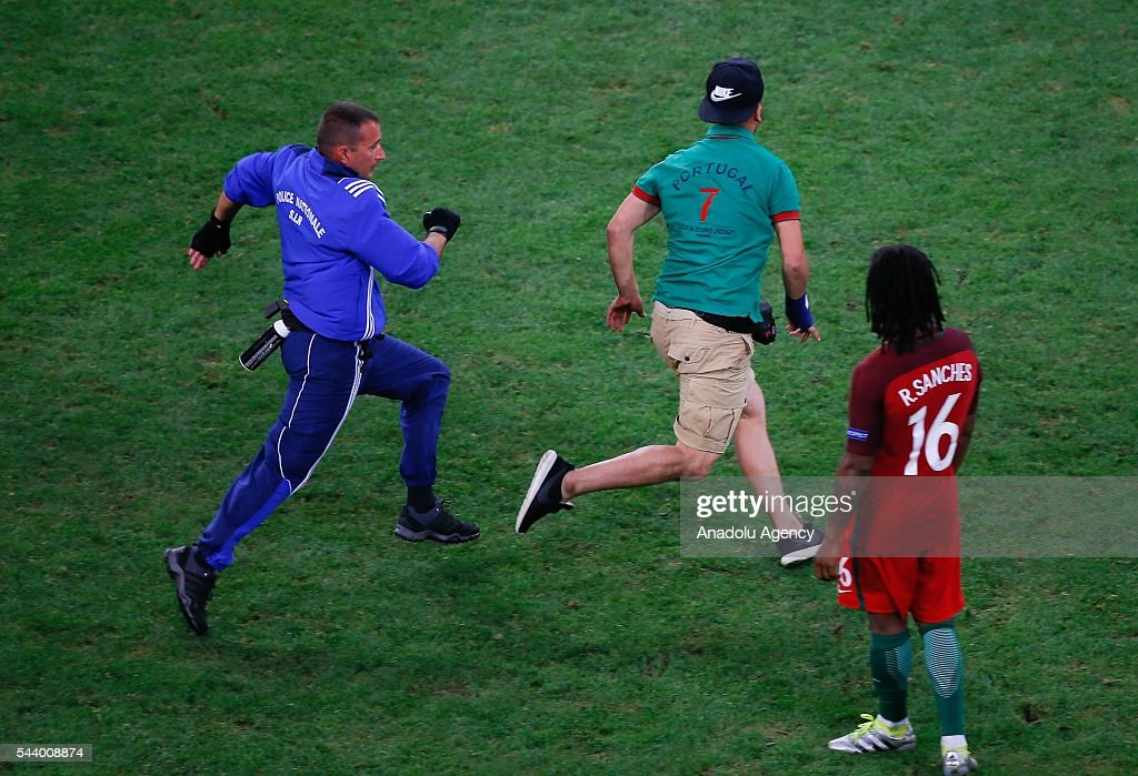 A pitch invader runs during the Euro 2016 quarter-final football match between Poland and Portugal at the Stade Velodrome in Marseille, France on June 30, 2016.