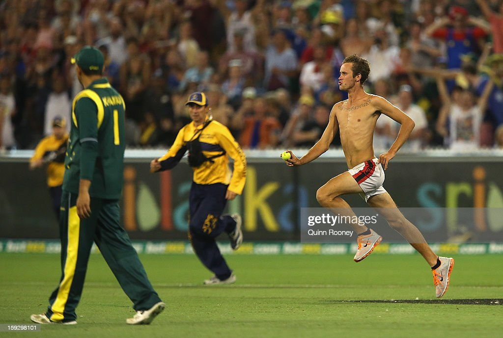 A pitch invader runs onto the field during game one of the Commonwealth Bank One Day International series between Australia and Sri Lanka at Melbourne Cricket Ground on January 11, 2013 in Melbourne, Australia.