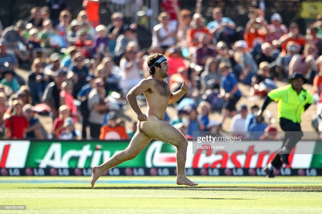 A pitch invader runs onto the field during the 2015 ICC Cricket World Cup match between England and Scotland at Hagley Oval on February 23 2015 in...