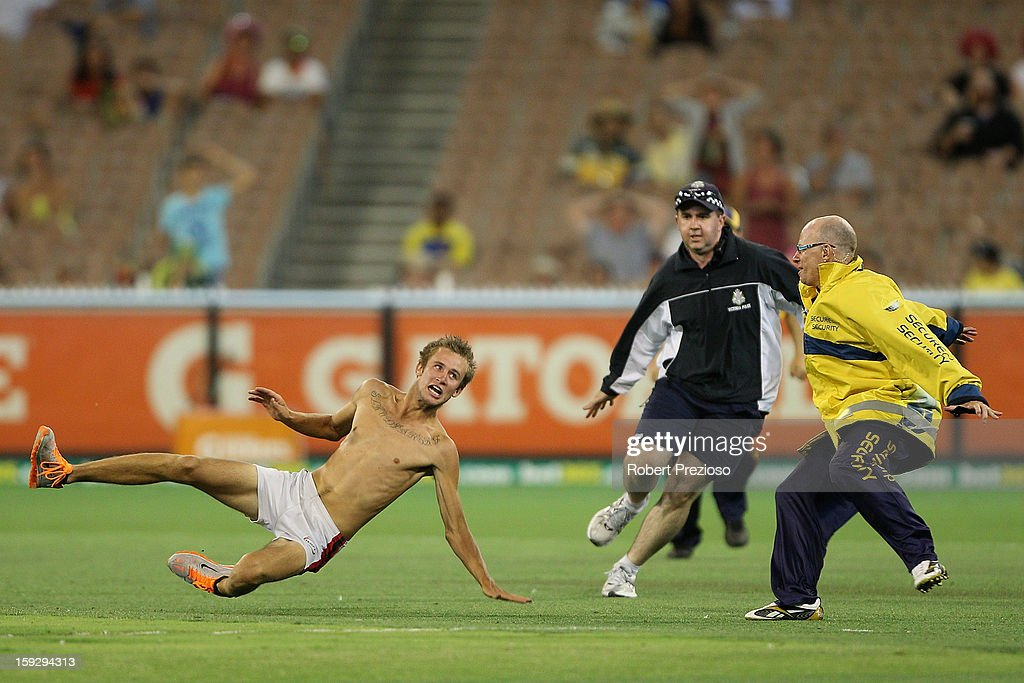 A pitch invader tries to outrun security during game one of the Commonwealth Bank One Day International series between Australia and Sri Lanka at Melbourne Cricket Ground on January 11, 2013 in Melbourne, Australia.