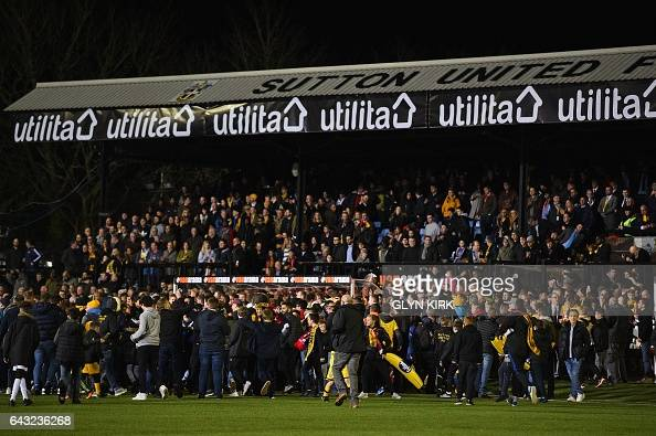 Pitch invasion by Sutton fans after the English FA Cup fifth round football match between Sutton United and Arsenal at the Borough Sports Ground...