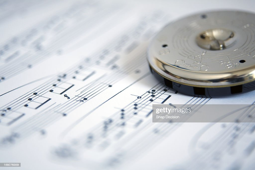 Pitch pipe on sheet music : Stock Photo