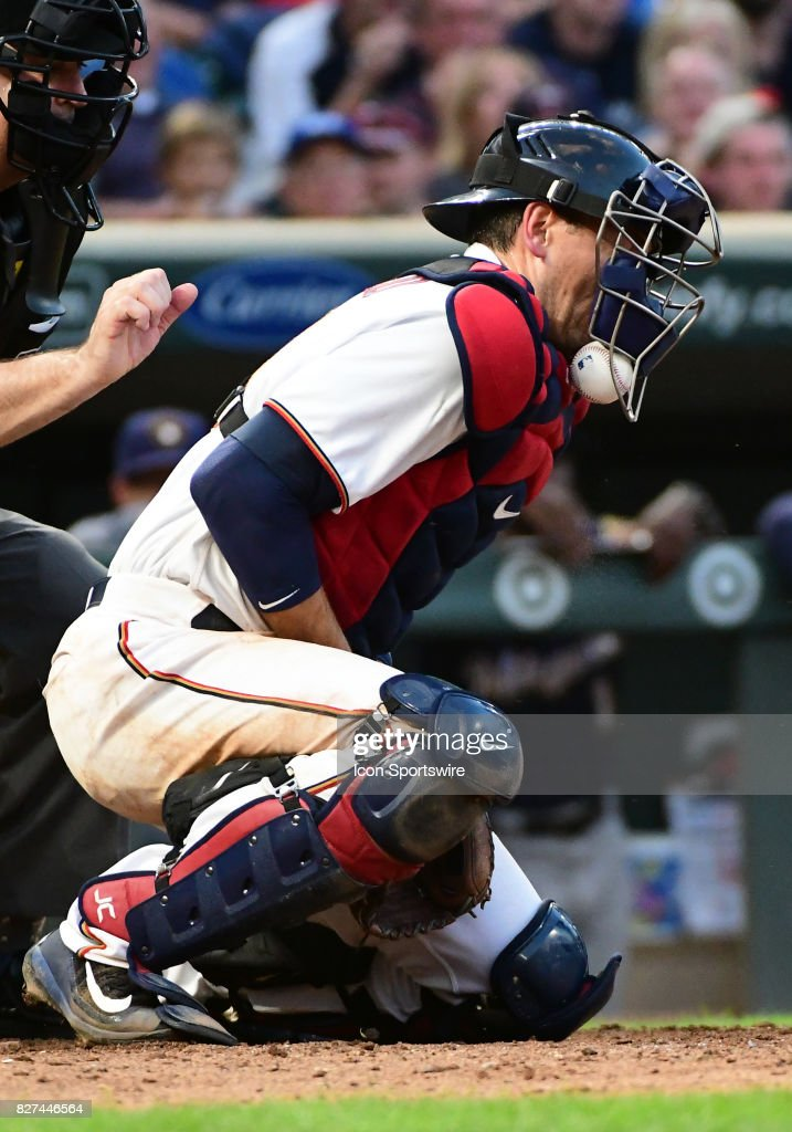 A pitch thrown by Minnesota Twins Starting pitcher Ervin Santana (54) hits the dirt and bounces under the mask of Minnesota Twins Catcher Jason Castro (21) during a MLB game between the Minnesota Twins and Milwaukee Brewers on August 7, 2017 at Target Field in Minneapolis, MN. The Twins defeated the Brewers 5-4.