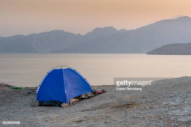 Pitched tent near water