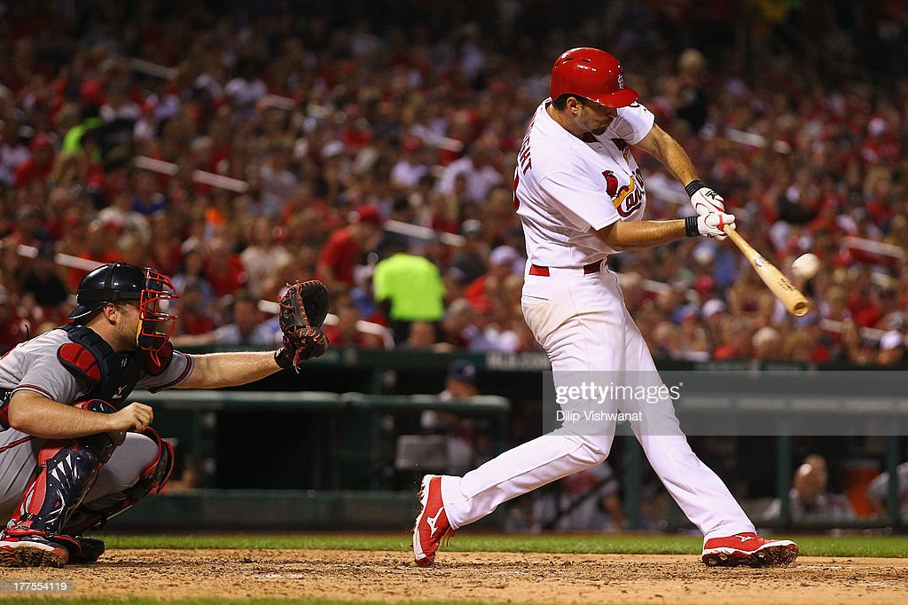 Pitcher <a gi-track='captionPersonalityLinkClicked' href=/galleries/search?phrase=Adam+Wainwright&family=editorial&specificpeople=547879 ng-click='$event.stopPropagation()'>Adam Wainwright</a> #50 of the St. Louis Cardinals knocks in a run on a sacrifice against the Atlanta Braves in the seventh at Busch Stadium on August 23, 2013 in St. Louis, Missouri.