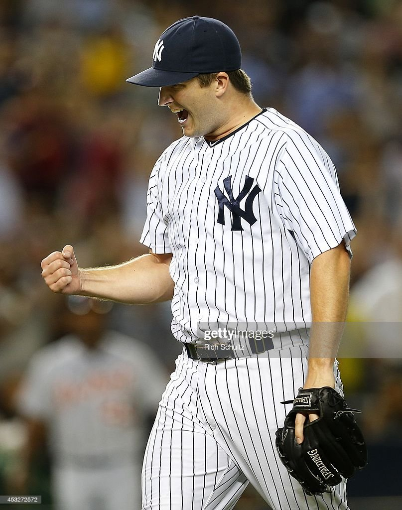 Pitcher Adam Warren #43 of the New York Yankees pumps his fist after getting out of a jam in the eighth inning against the Detroit Tigers in a MLB baseball game at Yankee Stadium on August 6, 2014 in the Bronx borough of New York City. The Yankees defeated the Tigers 5-1.