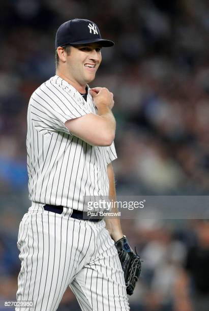 Pitcher Adam Warren of the New York Yankees reacts in an MLB baseball game against the Detroit Tigers on August 1 2017 at Yankee Stadium in the Bronx...