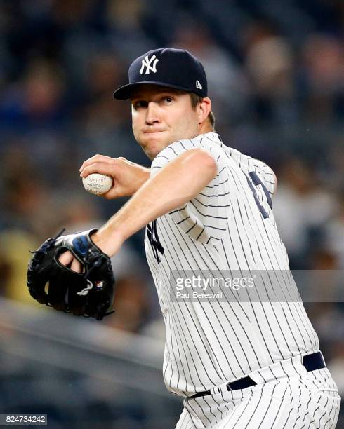 Pitcher Adam Warren of the New York Yankees throws to first base in an MLB baseball game against the Tampa Bay Rays on July 27 2017 at Yankee Stadium...