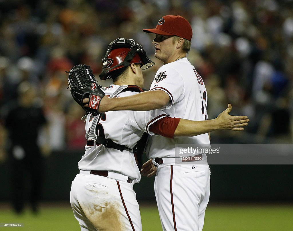 Pitcher Addison Reed #43 of the Arizona Diamondbacks is congratulated by catcher <a gi-track='captionPersonalityLinkClicked' href=/galleries/search?phrase=Miguel+Montero&family=editorial&specificpeople=836495 ng-click='$event.stopPropagation()'>Miguel Montero</a> #26 after pitching the ninth inning for a save against the San Francisco Giants during a MLB game at Chase Field on April 1, 2014 in Phoenix, Arizona. The Diamondbacks defeated the Giants 5-4.