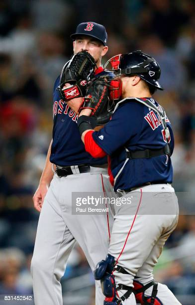 Pitcher Addison Reed of the Boston Red Sox talks with catcher Christian Vazquez of the Boston Red Sox in the 8th inning in an MLB baseball game...