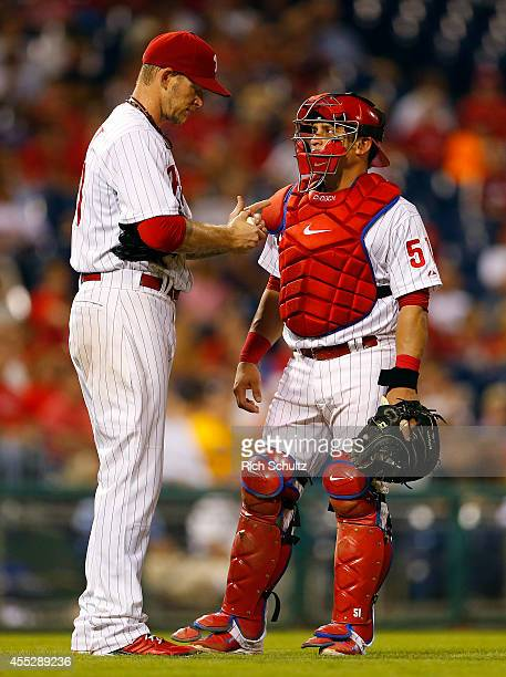 Pitcher AJ Burnett and catcher Carlos Ruiz of the Philadelphia Phillies meet on the mound during the sixth inning against the Pittsburgh Pirates in a...