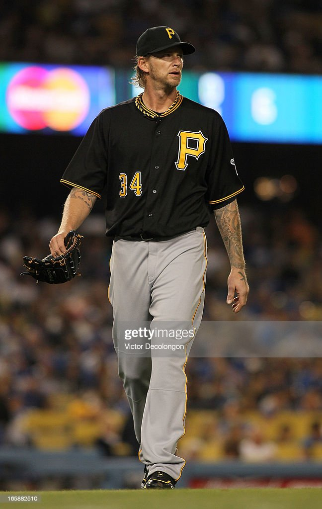 Pitcher <a gi-track='captionPersonalityLinkClicked' href=/galleries/search?phrase=A.J.+Burnett&family=editorial&specificpeople=213103 ng-click='$event.stopPropagation()'>A.J. Burnett</a> #34 of the Pittsburgh Pirates walks toward the dugout after being relieved by pitcher Jared Hughes #48 (not in photo) in the sixth inning during the MLB game against the Los Angeles Dodgers at Dodger Stadium on April 6, 2013 in Los Angeles, California.