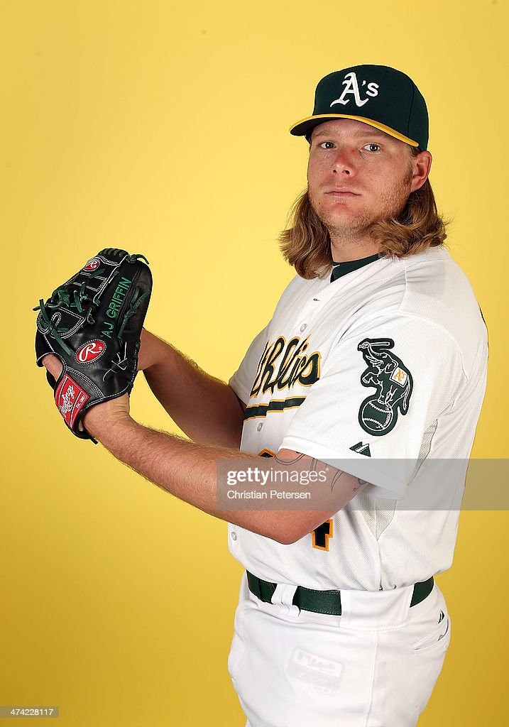 Pitcher A.J. Griffin #64 of the Oakland Athletics poses for a portrait during the spring training photo day at Phoenix Municipal Stadium on February 22, 2014 in Phoenix, Arizona.