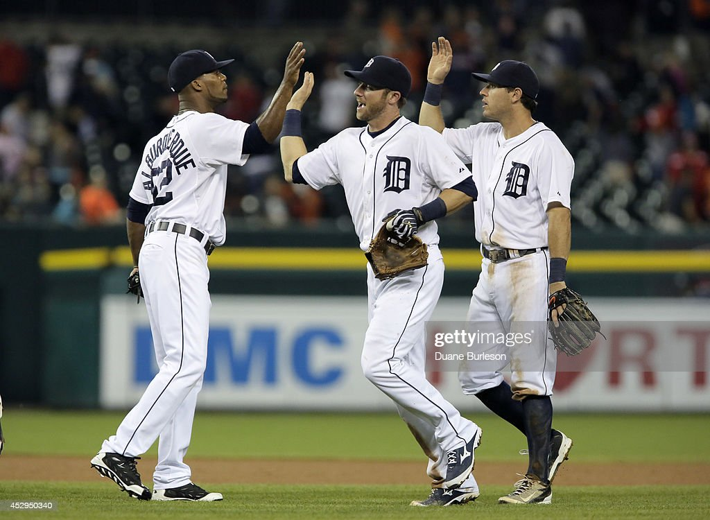 Pitcher Al Alburquerque of the Detroit Tigers celebrates a 732 win over the Chicago White Sox with Andrew Romine and Ian Kinsler at Comerica Park on...