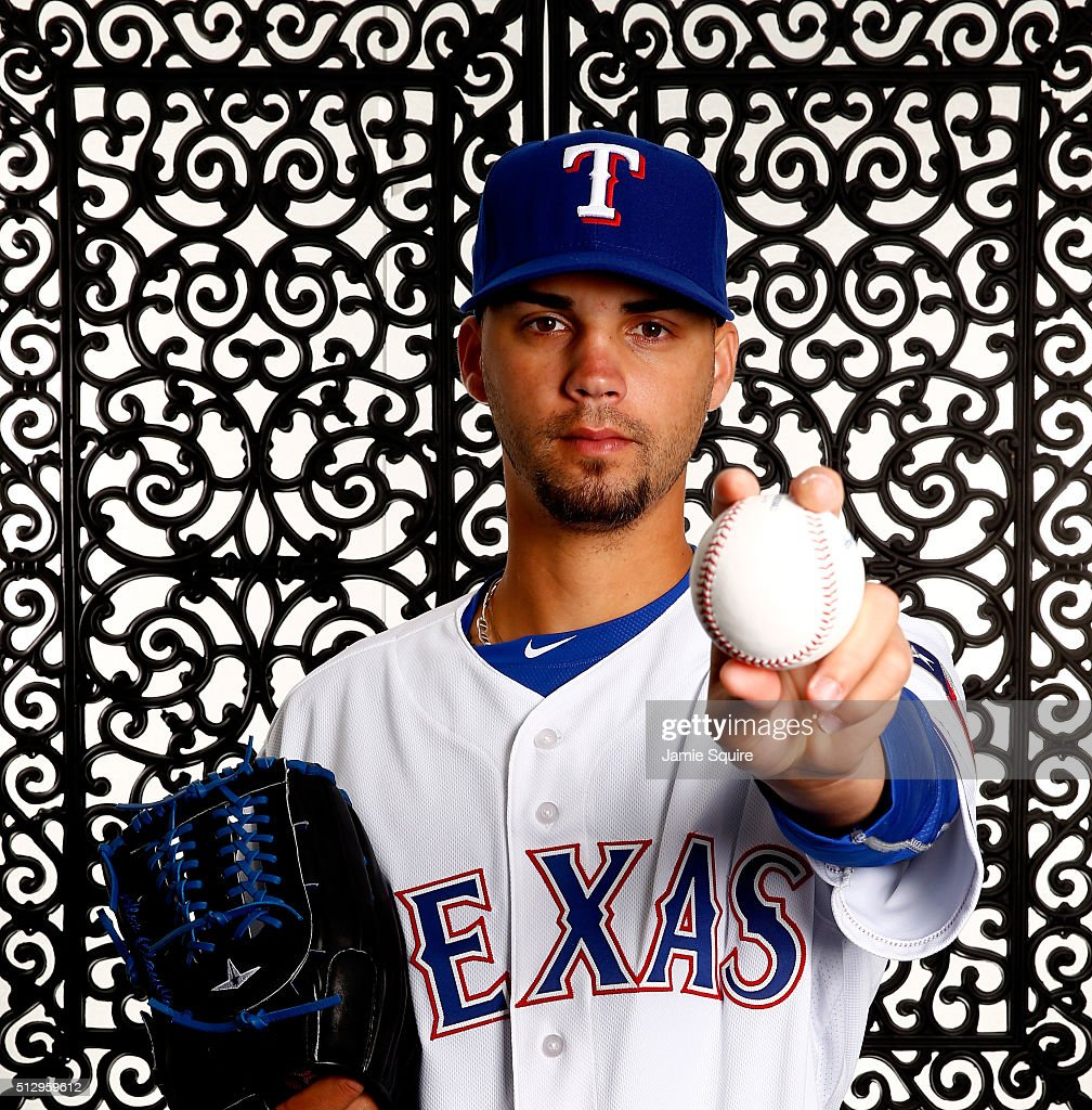 Pitcher Alex Claudio #58 of the Texas Rangers poses during a spring training photo shoot on February 28, 2016 in Surprise, Arizona.