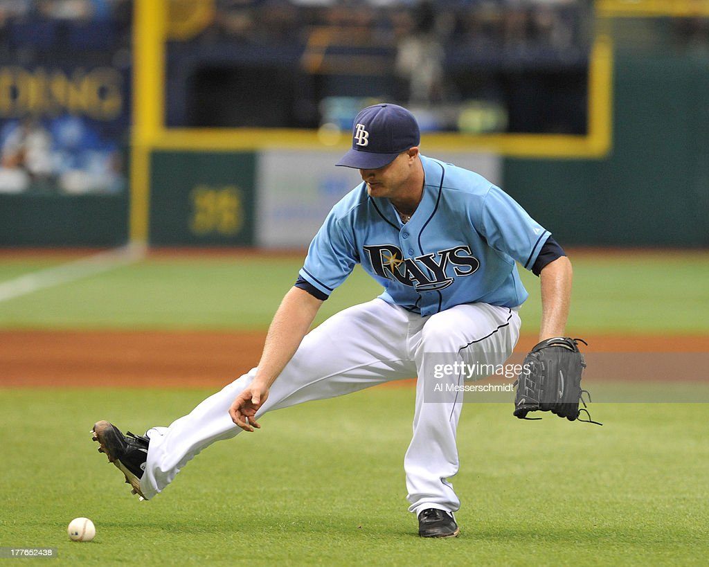 Pitcher <a gi-track='captionPersonalityLinkClicked' href=/galleries/search?phrase=Alex+Cobb&family=editorial&specificpeople=7512114 ng-click='$event.stopPropagation()'>Alex Cobb</a> #53 of the Tampa Bay Rays fields an infield hit against the New York Yankees August 25, 2013 at Tropicana Field in St. Petersburg, Florida.