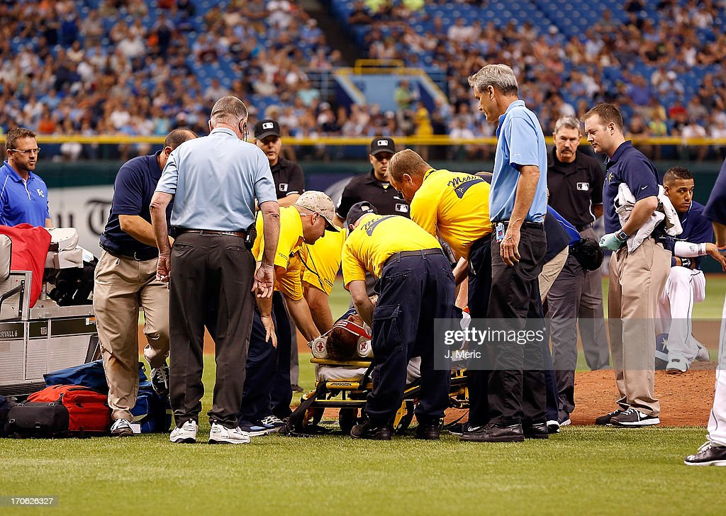Pitcher Alex Cobb #53 of the Tampa Bay Rays is taken off the field by medical personel after he was hit in the head by a line drive from the Kansas City Royals during the game at Tropicana Field on June 15, 2013 in St. Petersburg, Florida.