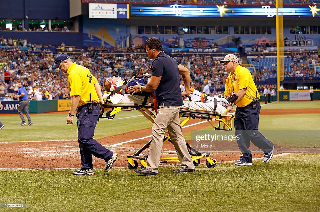 Pitcher <a gi-track='captionPersonalityLinkClicked' href=/galleries/search?phrase=Alex+Cobb&family=editorial&specificpeople=7512114 ng-click='$event.stopPropagation()'>Alex Cobb</a> #53 of the Tampa Bay Rays is taken off the field by medical personel after he was hit in the head by a line drive from the Kansas City Royals during the game at Tropicana Field on June 15, 2013 in St. Petersburg, Florida.