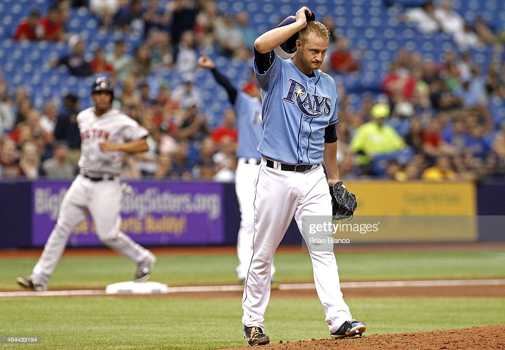 Pitcher Alex Cobb #53 of the Tampa Bay Rays reacts on the mound following his throwing error allowing Xander Bogaerts #2 of the Boston Red Sox to advance from first base to third base during the third inning of a game on August 31, 2014 at Tropicana Field in St. Petersburg, Florida.
