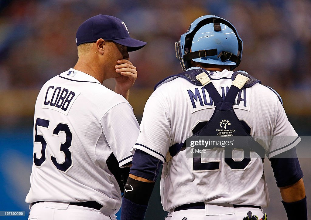 Pitcher <a gi-track='captionPersonalityLinkClicked' href=/galleries/search?phrase=Alex+Cobb&family=editorial&specificpeople=7512114 ng-click='$event.stopPropagation()'>Alex Cobb</a> #53 of the Tampa Bay Rays talks with catcher <a gi-track='captionPersonalityLinkClicked' href=/galleries/search?phrase=Jose+Molina&family=editorial&specificpeople=206365 ng-click='$event.stopPropagation()'>Jose Molina</a> during the game against the New York Yankees at Tropicana Field on April 24, 2013 in St. Petersburg, Florida.