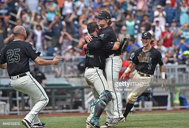 Pitcher Alex Cunningham and catcher David Parrett of the Coastal Carolina Chanticleers embrace after striking out the final batter to beat the...