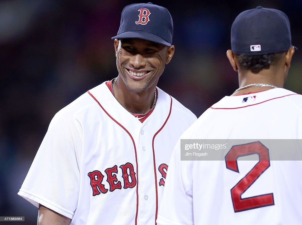 Pitcher Alexi Ogando #41 of the Boston Red Sox reacts after getting out of trouble in the seventh inning against the Toronto Blue Jays at Fenway Park April 27, 2015 in Boston, Massachusetts.