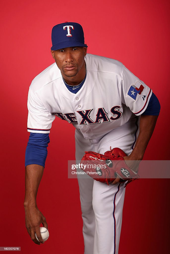 Pitcher <a gi-track='captionPersonalityLinkClicked' href=/galleries/search?phrase=Alexi+Ogando&family=editorial&specificpeople=6889214 ng-click='$event.stopPropagation()'>Alexi Ogando</a> #41 of the Texas Rangers poses for a portrait during spring training photo day at Surprise Stadium on February 20, 2013 in Surprise, Arizona.