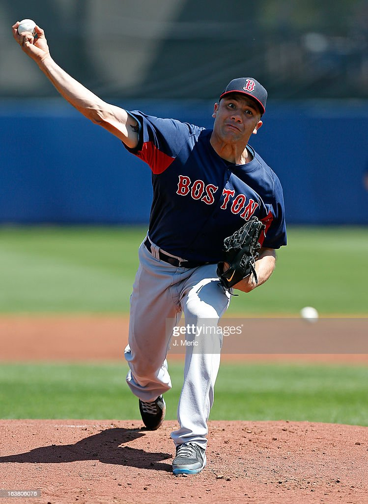 Pitcher <a gi-track='captionPersonalityLinkClicked' href=/galleries/search?phrase=Alfredo+Aceves&family=editorial&specificpeople=5514493 ng-click='$event.stopPropagation()'>Alfredo Aceves</a> #91 of the Boston Red Sox pitches against the Tampa Bay Rays during a Grapefruit League Spring Training Game at the Charlotte Sports Complex on March 16, 2013 in Port Charlotte, Florida.